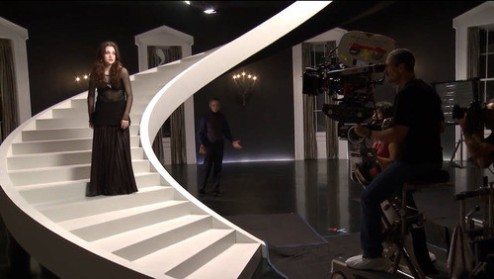Alice Englert and Jeremy Irons on set