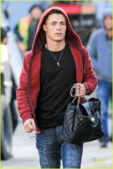 Colton Haynes with bag