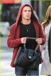 Colton Haynes with bag