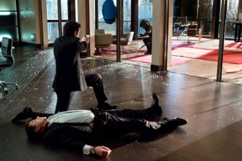 John Barrowman as Malcolm Merlyn, Colin Donnell as Tommy Merlyn, and Stephen Amell as The Arrow