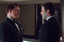 John Barrowman as Malcolm Merlyn and Colin Donnell as Tommy Merlyn